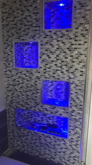 Photo tiled lit up bathroom niche