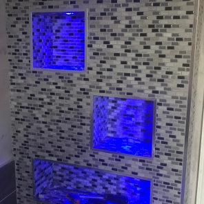 Photo tiled lit up bathroom niche